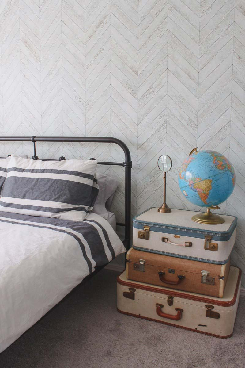 Striped bedding with suitecase side table
