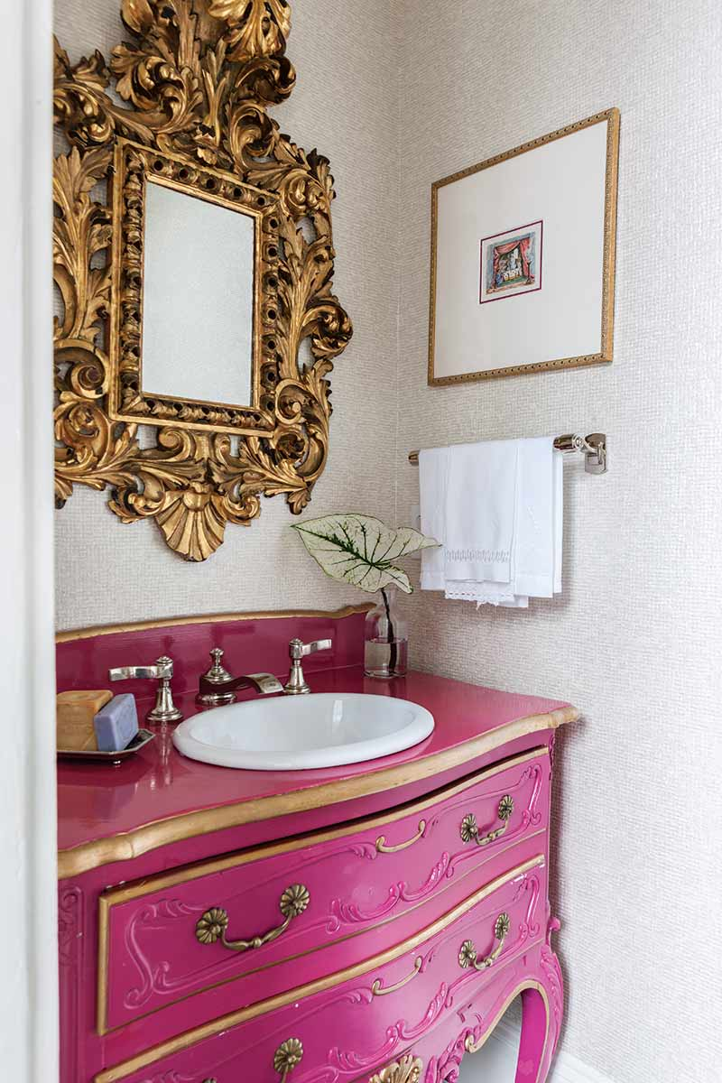 Powder room with bright pink pop of color