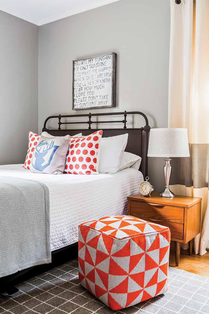 Young boy's room with gray walls and colorful accents