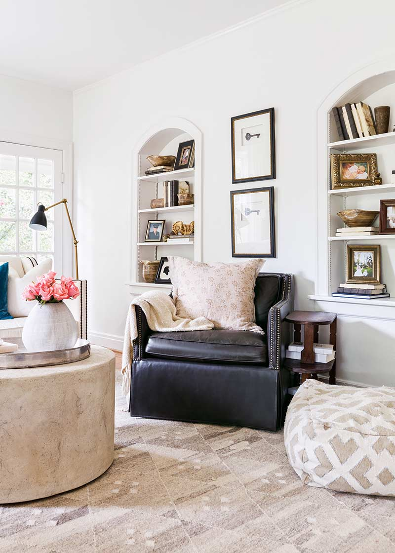 black leather chair in white painted living room