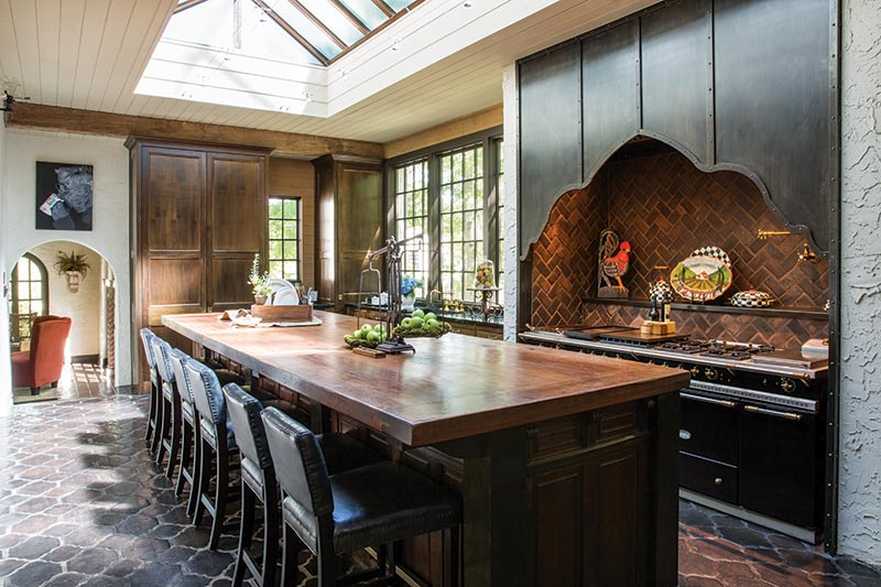 Large rustic kitchen with copper skylight