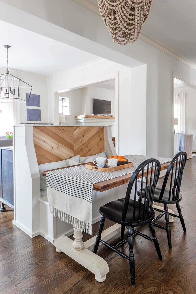 white and light wooden booth in large kitchen