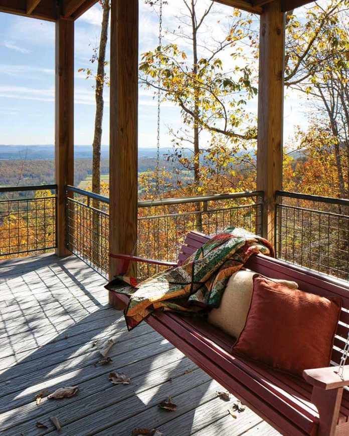 Porch swing overlooking autumn forrest