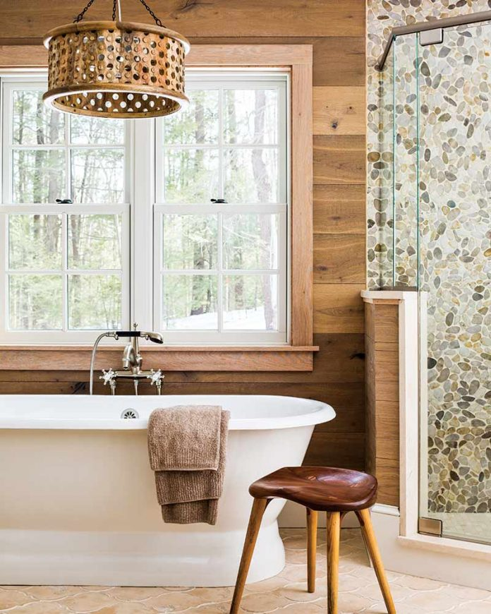 bathroom with dark wood shiplap and soaking tub
