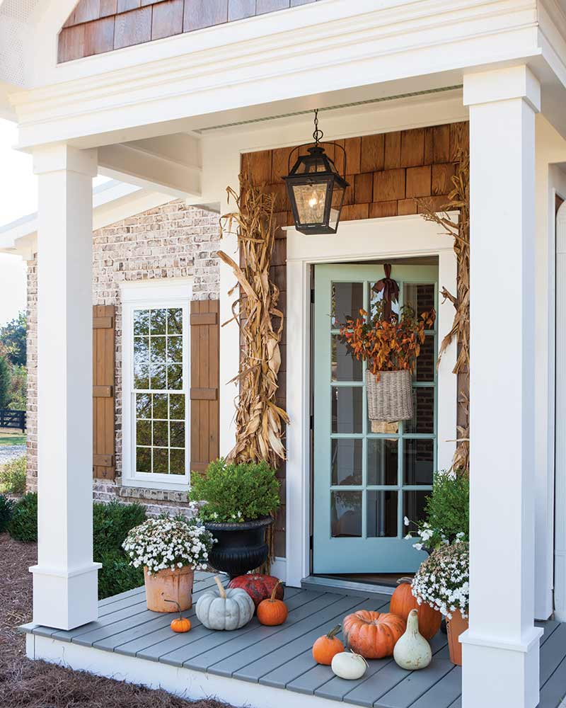 front exterior with blue door and fall decor