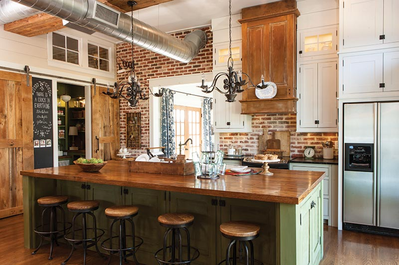 cottage kitchen with exposed brick and green island