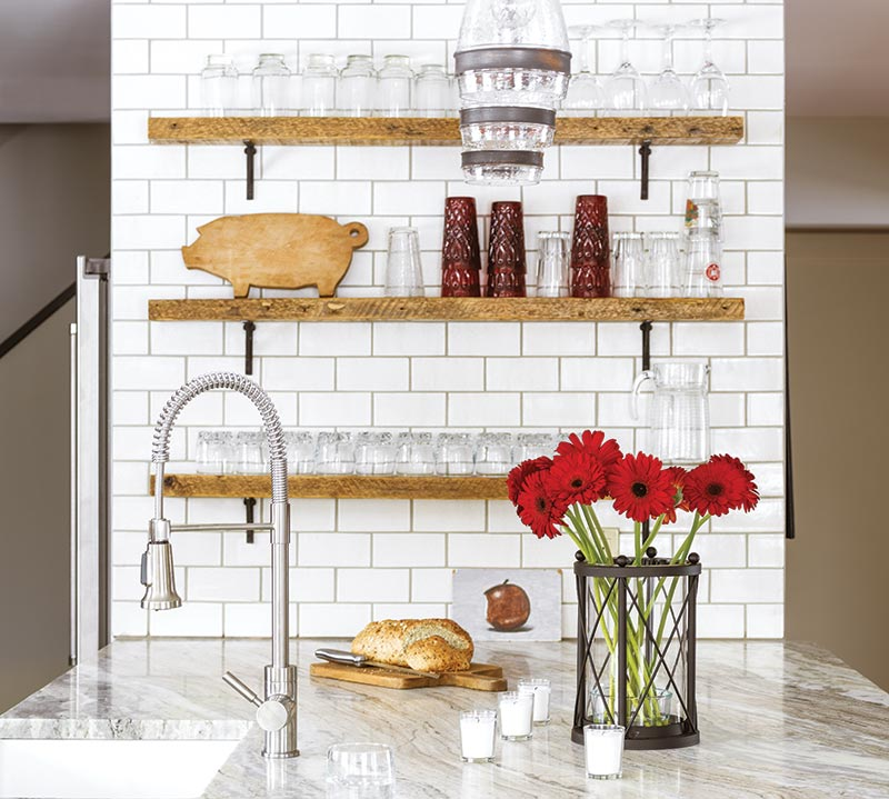 open shelving and red flowers