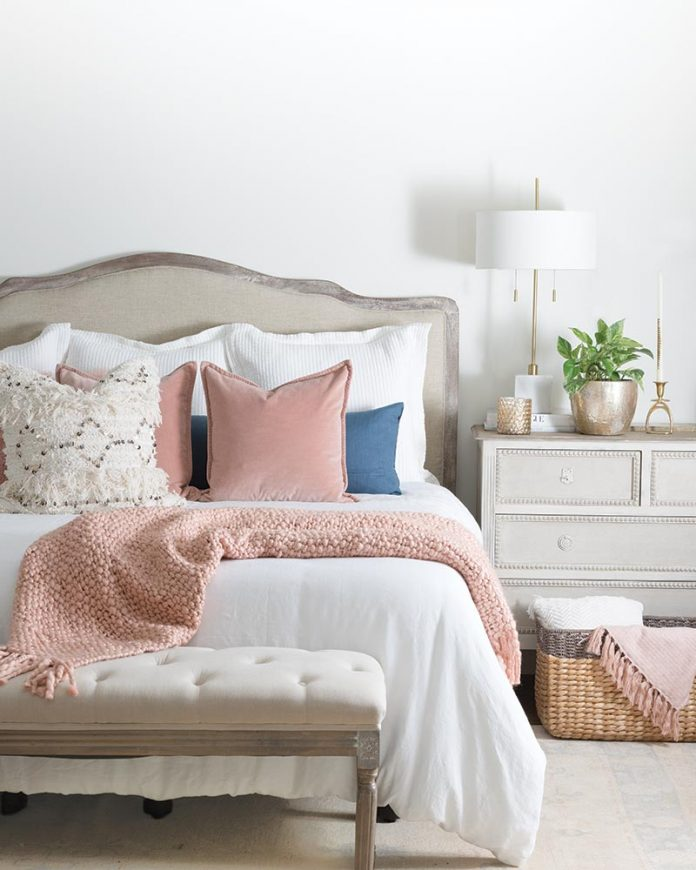 cottage bedroom with pink throw pillows
