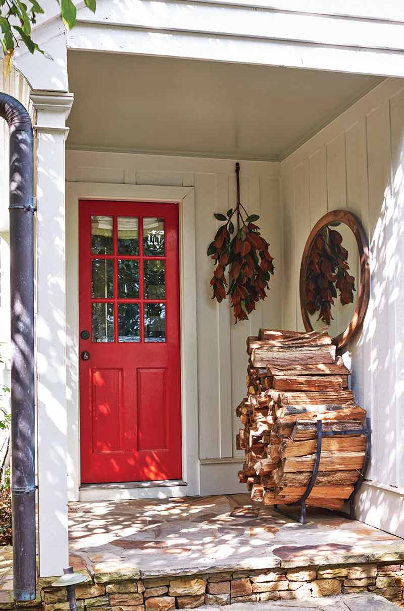 red front door and fire wood