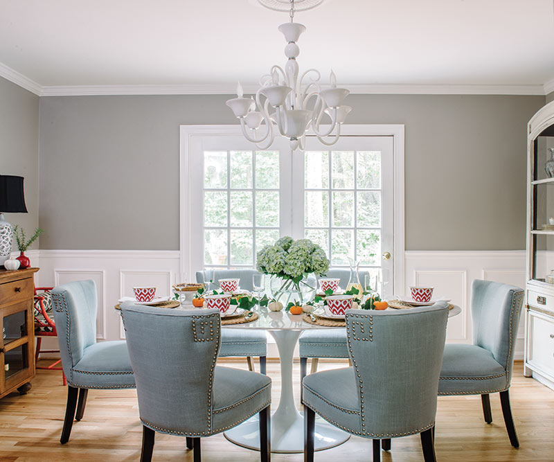 autumn dining room with greige walls and baby blue chairs