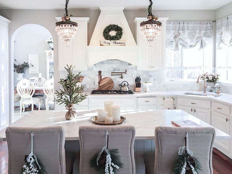 white kitchen with holiday greenery