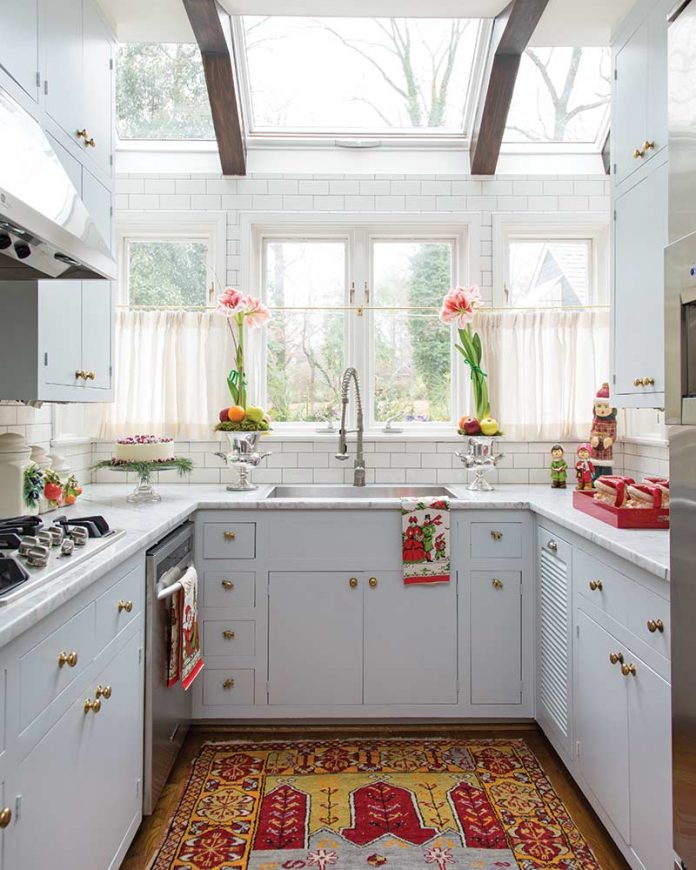 Quaint Christmas cottage kitchen with skylight and light gray cabinets