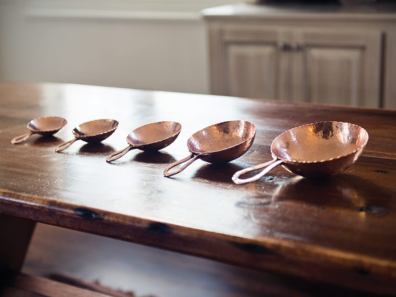 hand-made copper measuring cups