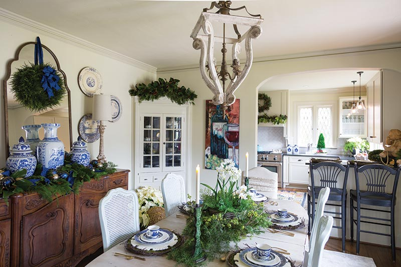 Blue and white China in dining room with Christmas greenery