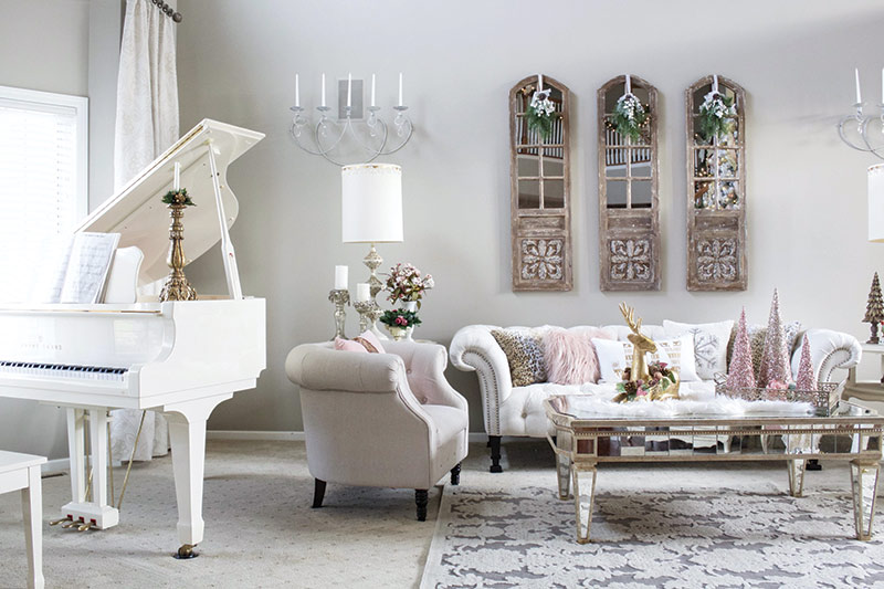 Vintage glam living room with white baby grand piano and Christmas decor