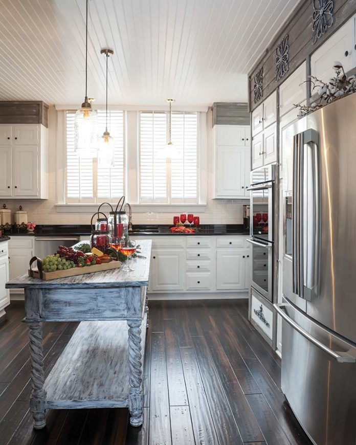 White kitchen with gray wooden island