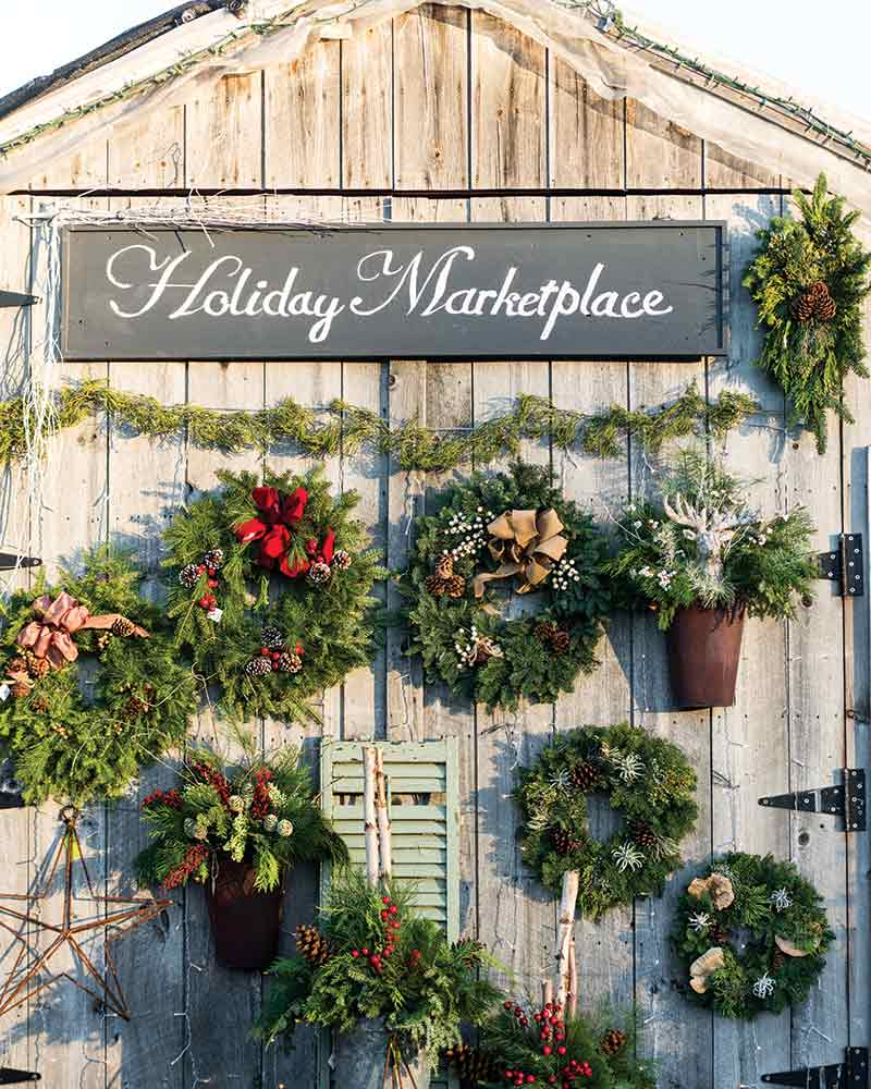 Holiday Marketplace barn wall with wreaths