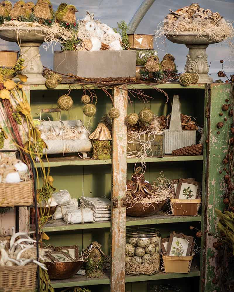 dresser with natural Christmas decorations displayed