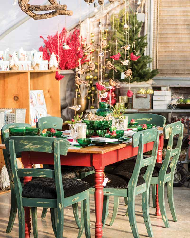 Holiday Marketplace red table with green chairs
