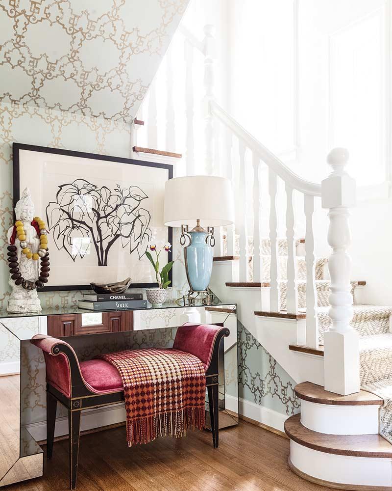 staircase and vibrant velvet bench