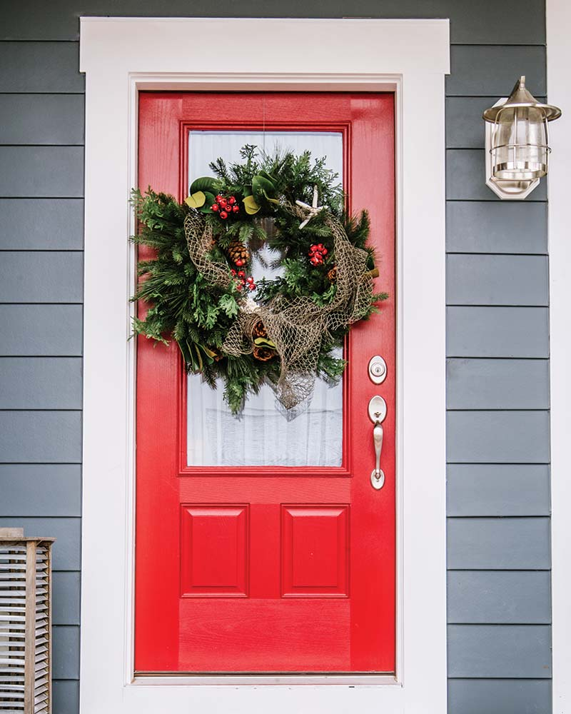 Red front door with nautical wreath