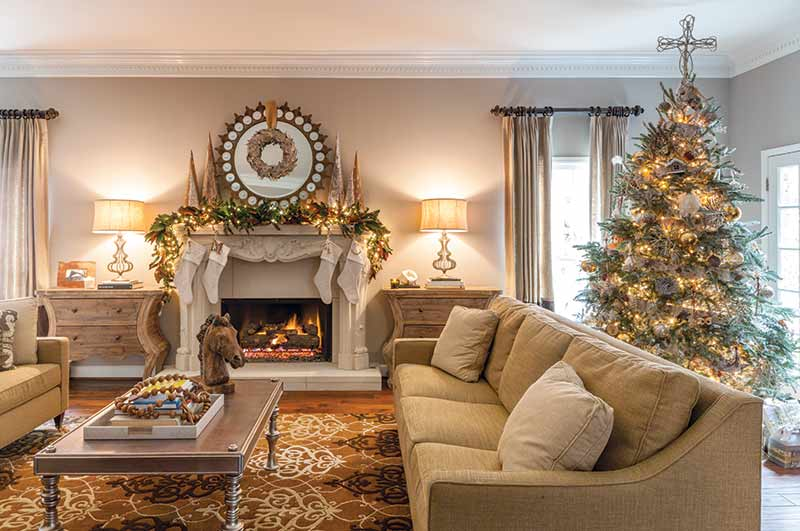 flocked tree in living room with fireplace