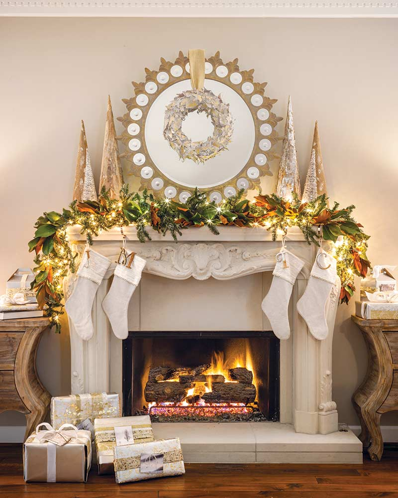 round wreath above mantel with garland and stockings