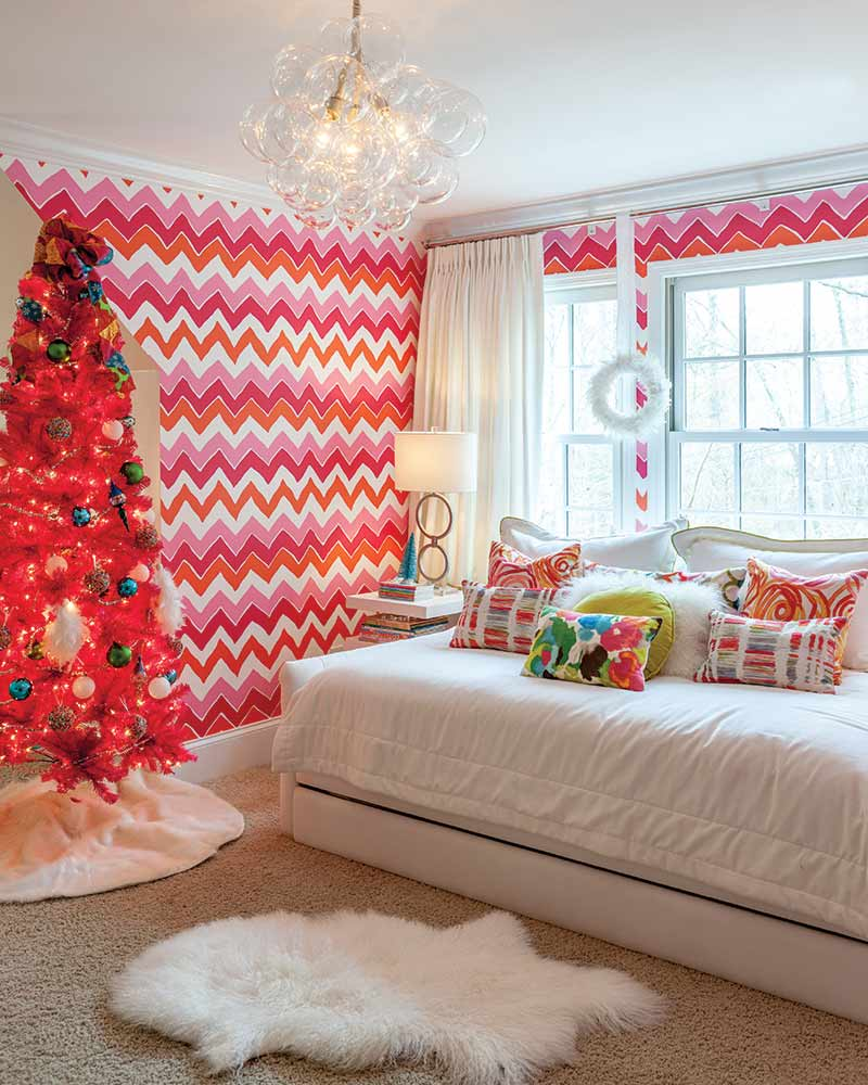 Bright pink Christmas tree in pink and white bedroom