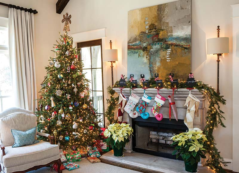 family room with Christmas tree and colorful stockings