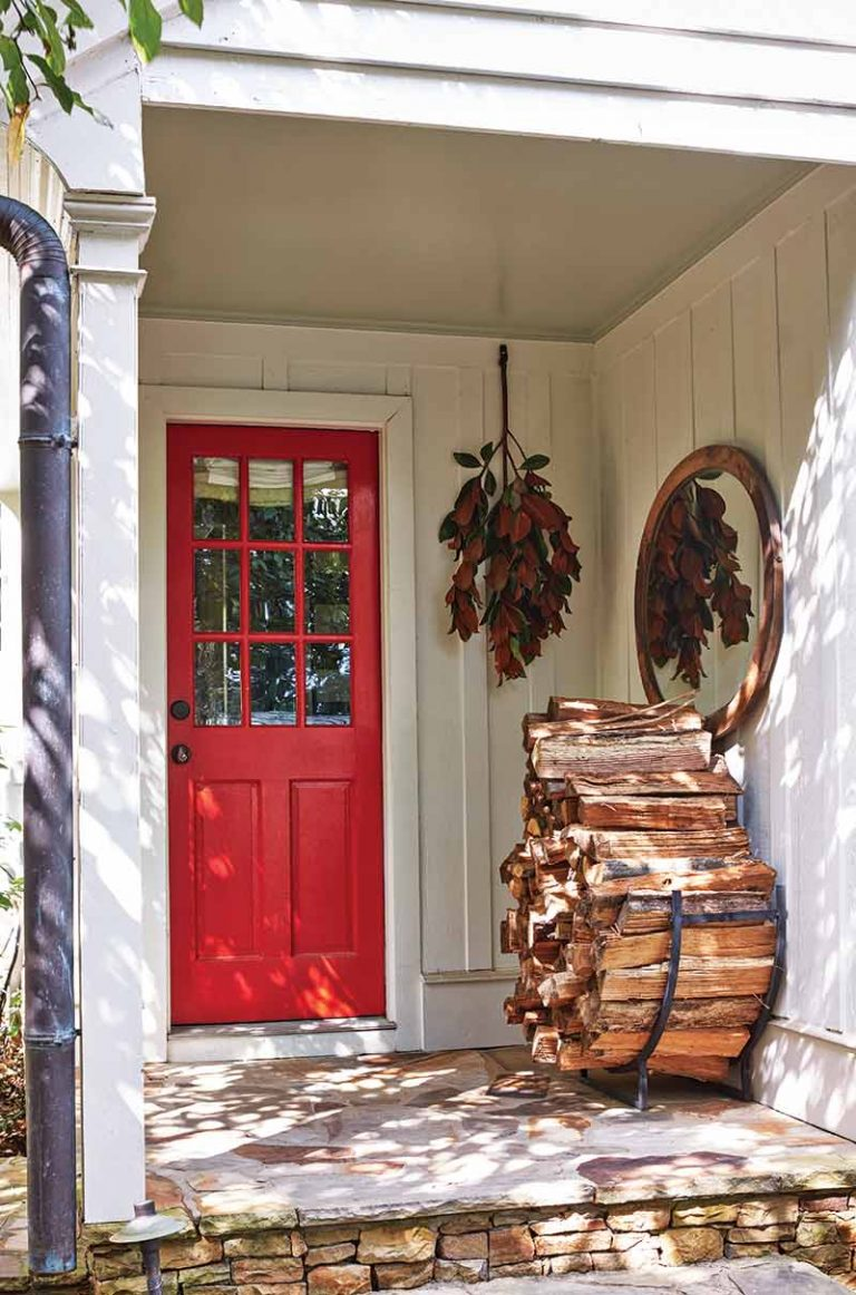 red front door and firewood
