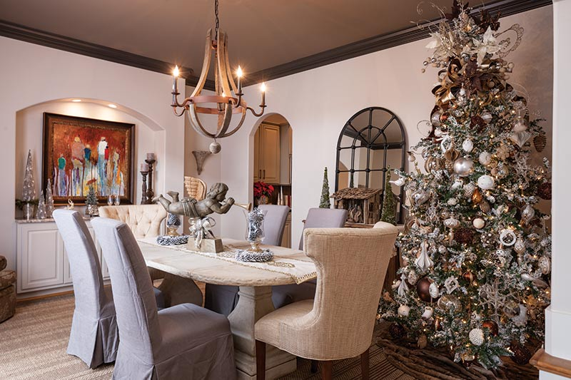 neutral dining room with flocked Christmas tree