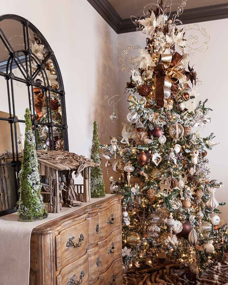 flocked Christmas tree with brown and metallic ornaments