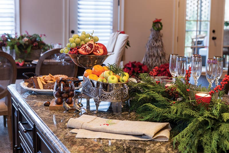 kitchen island with holiday snacks and decor