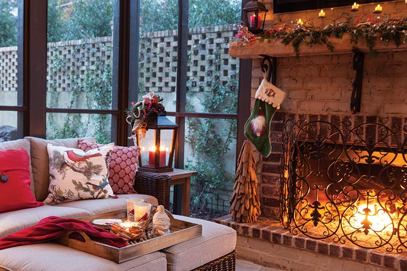 screened-in back porch with fireplace and Christmas decor