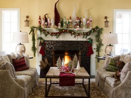 living room with garland and fireplace