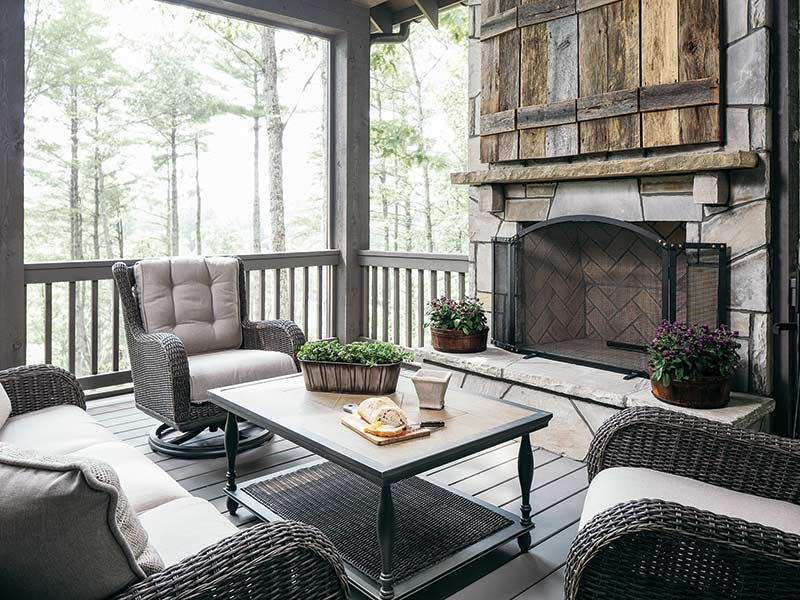 mountain home screened-in patio with fireplace