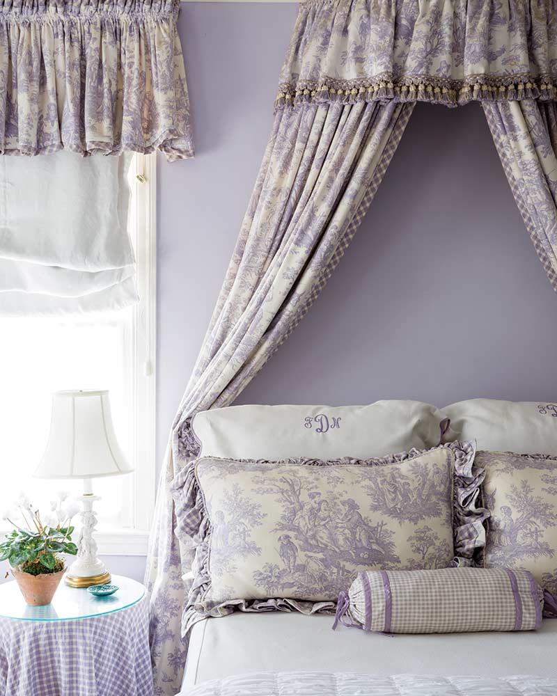 lavender girls room with canopy bed and matching drapes