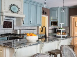 Kitchen with large island and light blur cabinets