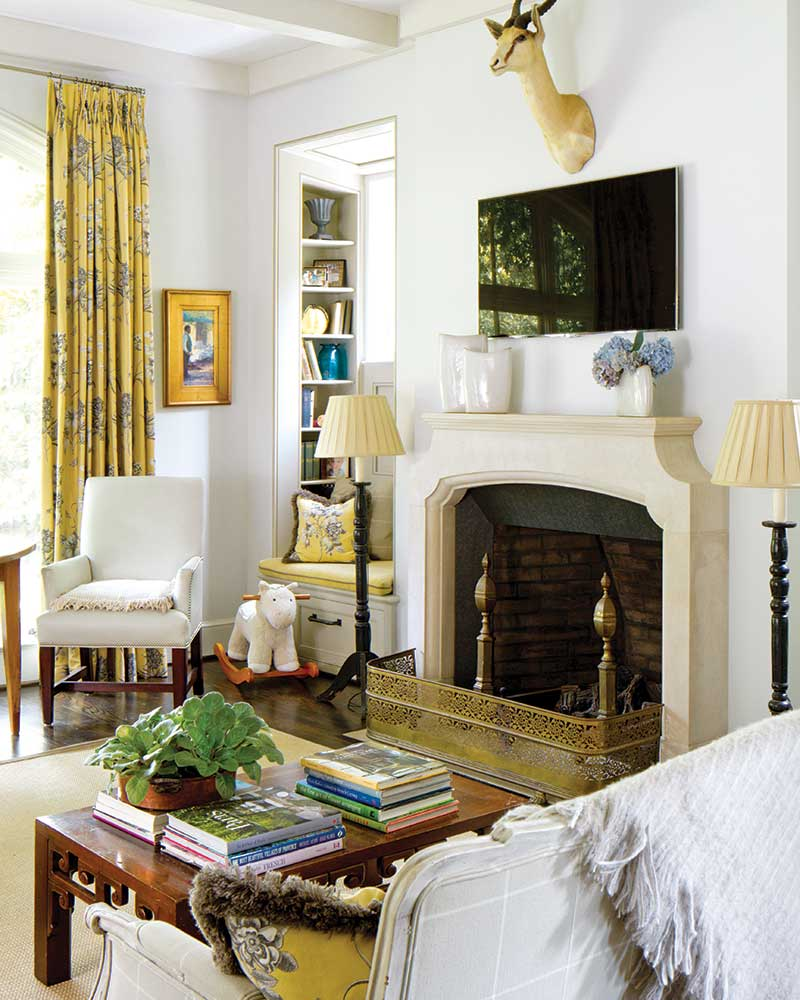 French-inspired sitting room with yellow accents and window seat
