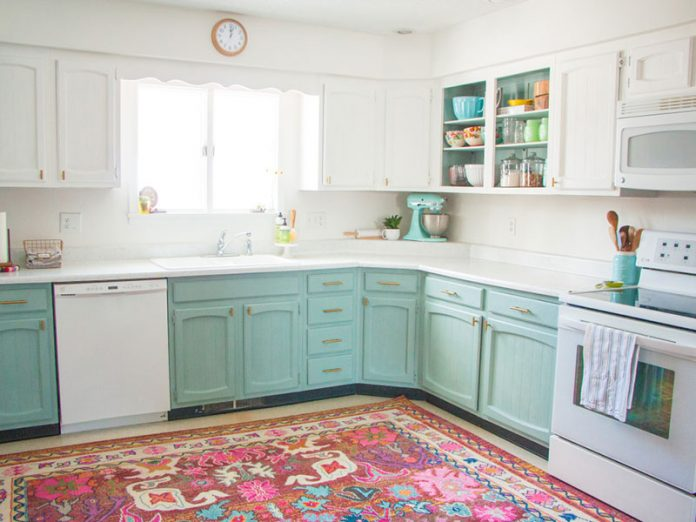 kitchen with light blue lower cabinets