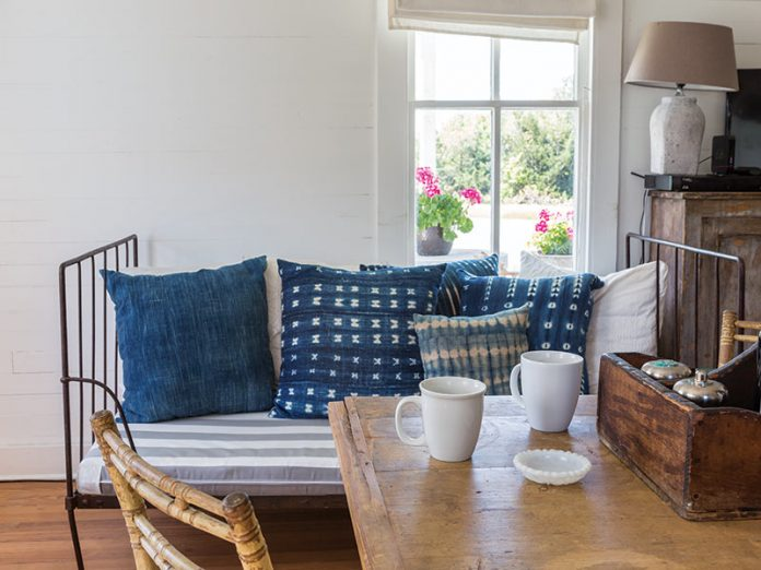 daybed with navy pattered throw pillows