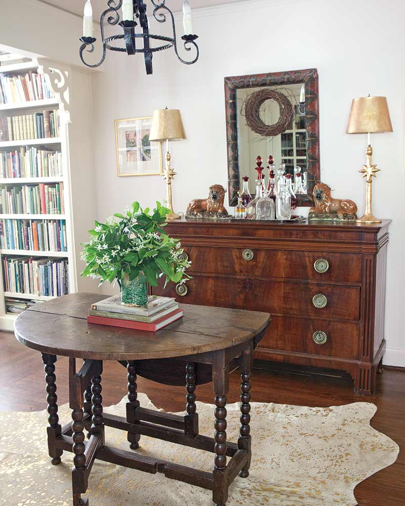 Gateleg table and vintage chest and home library