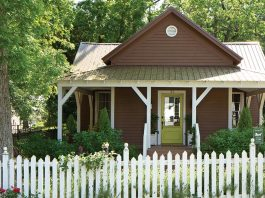cottage exterior and white picket fence