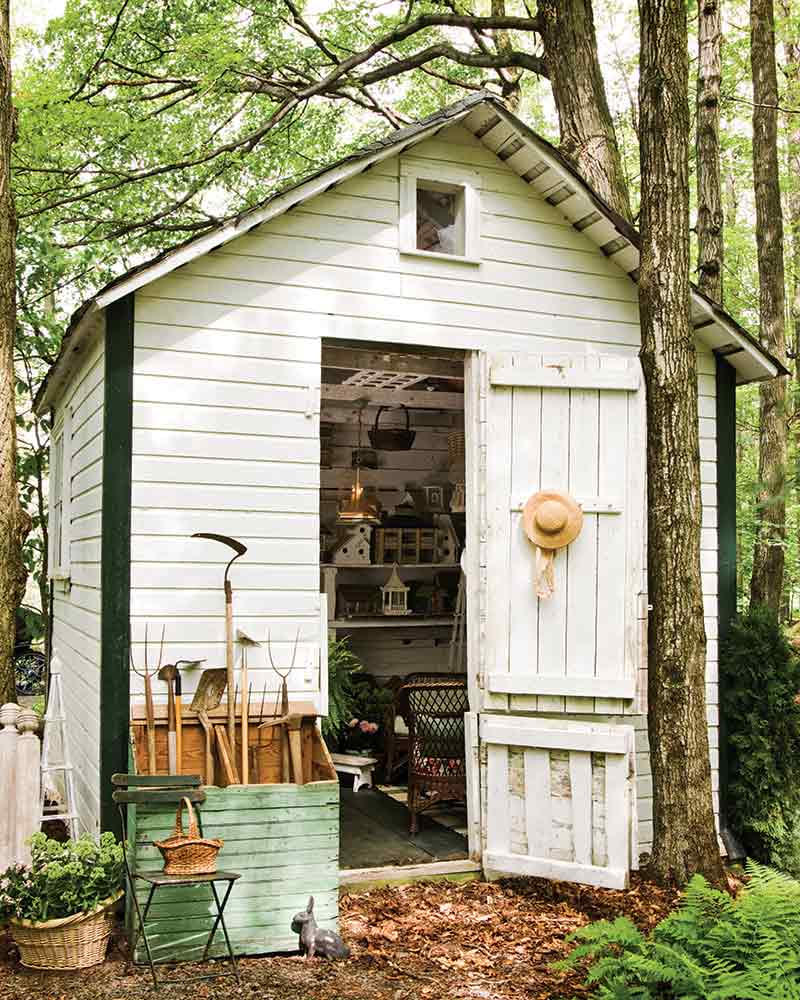 small white rustic garden shed