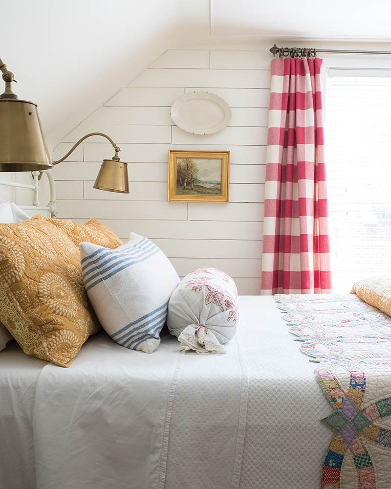 country style bedroom with red gingham curtains