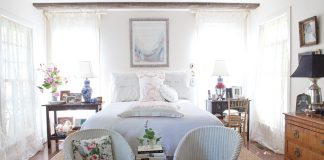 master suite with white vintage linens