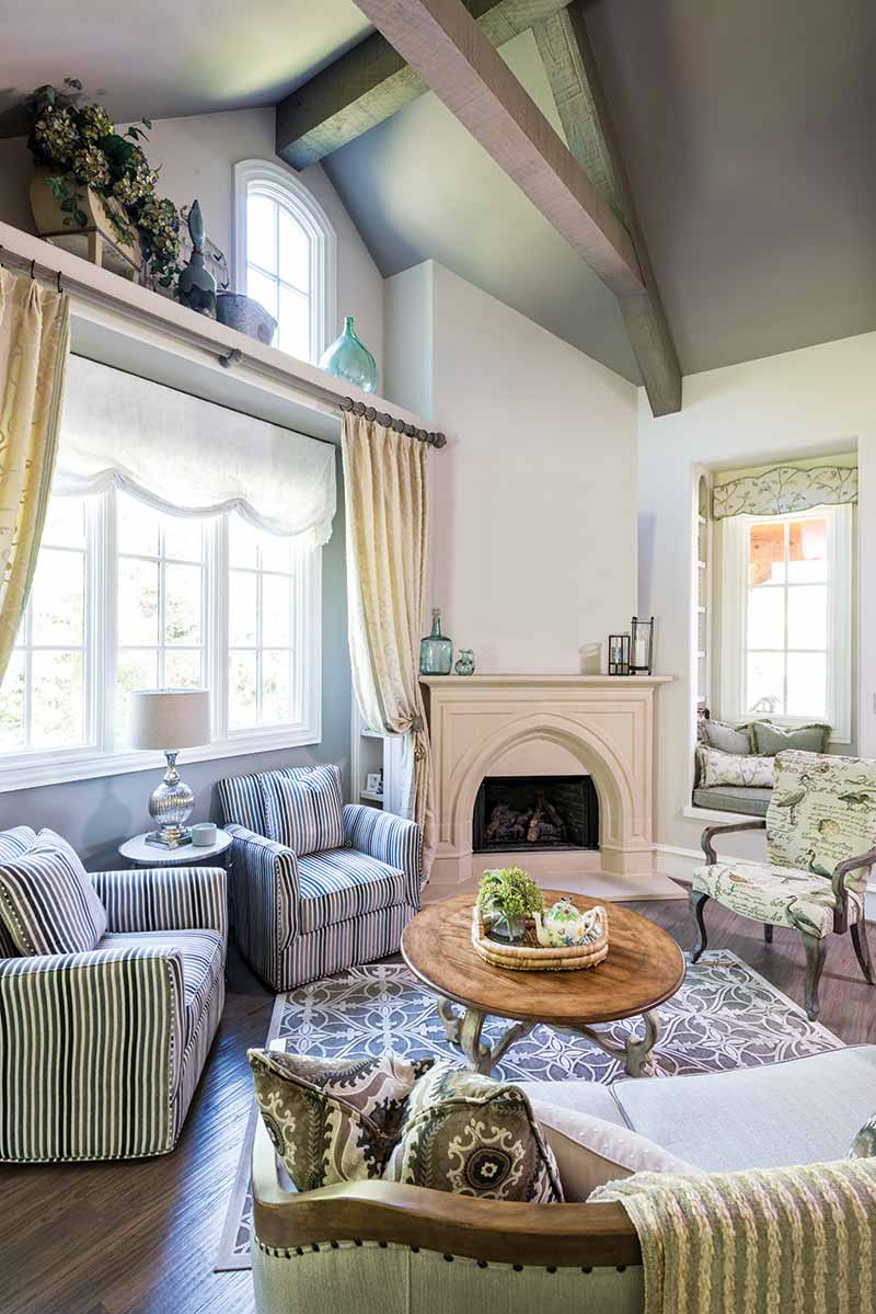 Cottage living room with soaring vaulted ceilings.