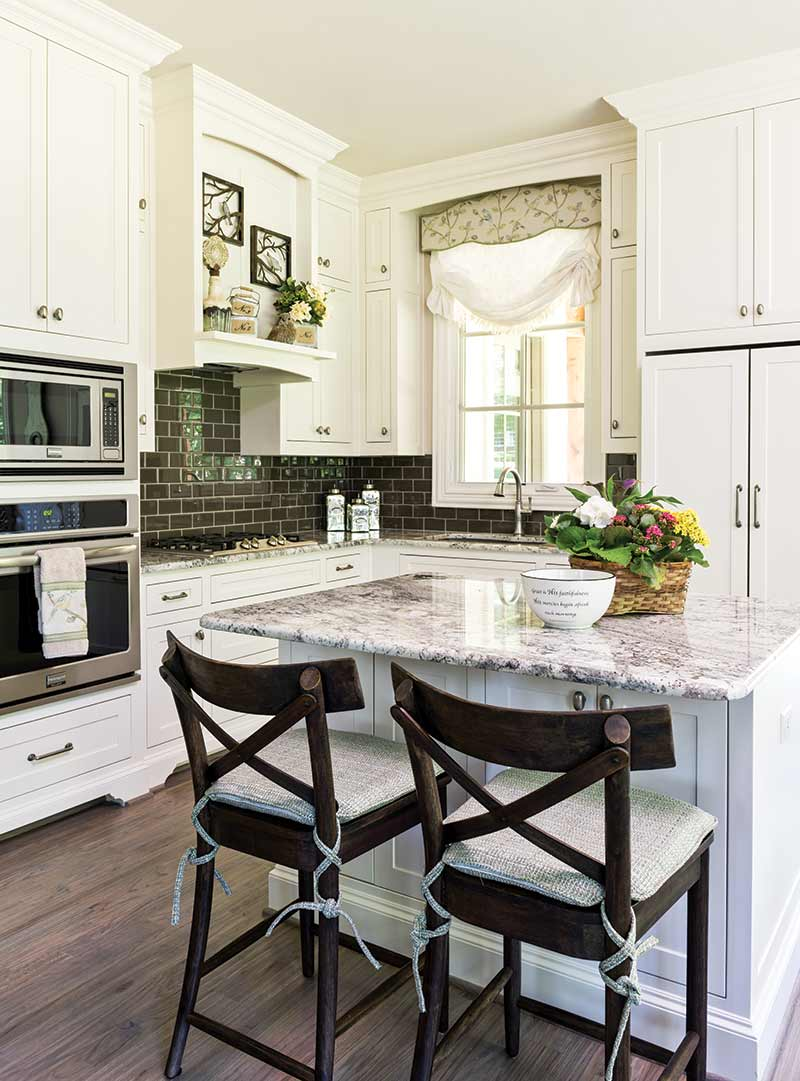white kitchen with dark gray tile backsplash