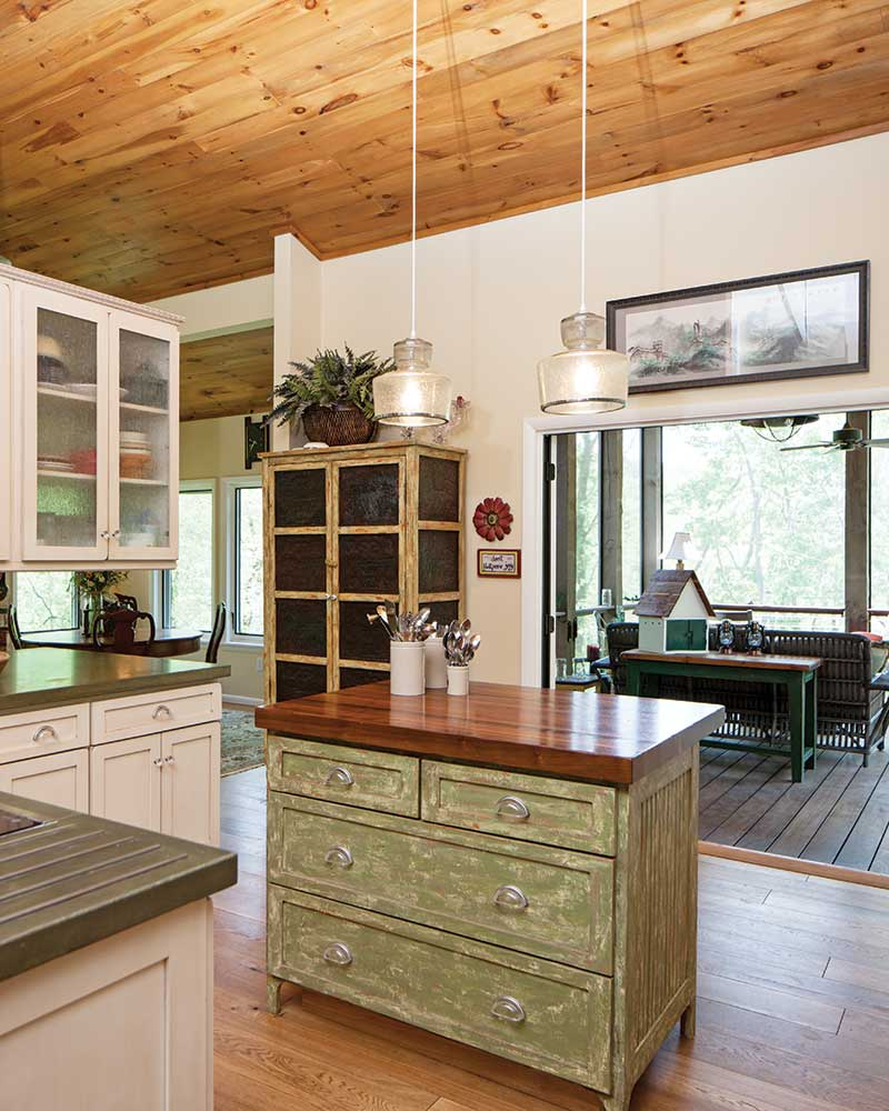 Country style cottage kitchen with green-painted island