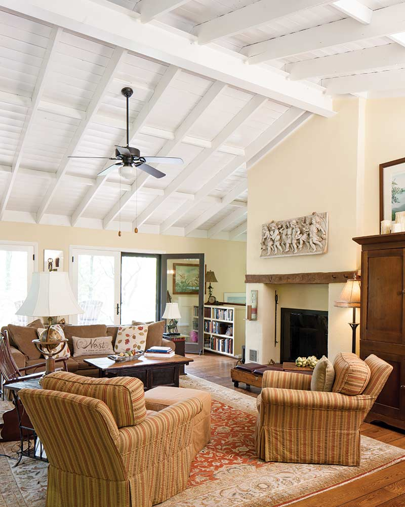 living room with white wood vaulted ceiling